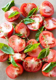 Tomatoes, fresh thyme and basil, drizzle with evoo, and a sprinkle of salt. Perfect for summer