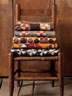 Vintage quilts are shown to advantage on a beautiful chair. Both a storage solution and a beautiful way to display treasured quilts and antique chairs. Old Quilts, Antique Quilts, Small Quilts, Mini Quilts, Vintage Quilts, Batik Quilts, Antique Chairs, Country Decor, Rustic Decor