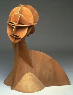 "Constructed Head No. 1, 1915, plywood, by Naum Gabo. Russian-born American sculptor Naum Gabo (1890-1977) was a pioneer of the Russian Constructivist art movement. His work utilized what is known as ""stereometric construction,"" by which form is achieved through the description of space rather than mass."