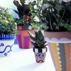 Painting fun designs on clay pots