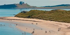 Beach at Low Newton with National Trust huts nestles in the dunes and Dunstanburgh Castle in the background- photo by Tony Hall Dunstanburgh Castle, Great Places, Places To Visit, Northumberland Coast, Durham City, North East England, Northern England, National Trust, Grand Tour