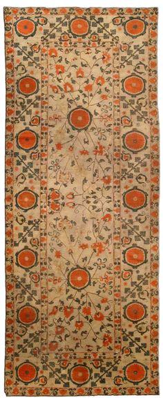 A Samarkand (Khotan) carpet BB4256 - by Doris Leslie Blau.  A late 19th century Samarkand (Khotan) antique carpet, having a light camel field with three orange enlarged abstract flower ...