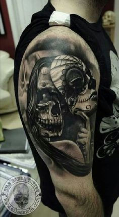 Skull with mask tattoo on sleeve - 100 Awesome Skull Tattoo Designs