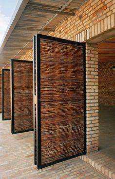 Dominikus Stark's Education Center in Rwanda. Brickwork is combined with wickerwork and steel door and window surrounds. (Architonic.com)