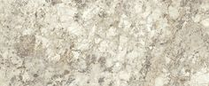 Spring Carnival - Wilsonart.  A confectioner's overture of white chocolate and creamy brown accented with grey tones creates flowing diagonal movement in this deliciously elegant and refreshing white Brazilian granite.