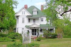 Queen Anne style Victorian Style 4 bedroom 2 bath with formal living and dining. Partially with updated kitchen and baths. Beautiful hardwood floors, walk-thru and bay windows, and stained glass throughout. Custom millwork revealed in the beautiful staircase, fire place mantles, wainscoting, and the bead board ceilings. Rocking chair front porch over looks the courtyard-like front yard. Storage building, carport, and fenced backyard. USDA area. Chester, South Carolina
