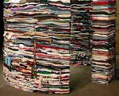 Layered sculptures imitating Geology, created with secondhand clothing. by Derick Melander