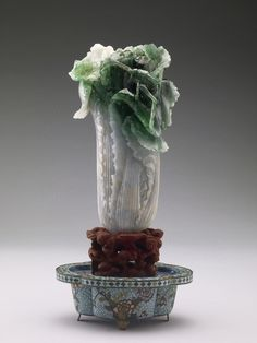 The Jadeite Cabbage ( 翠玉白菜, 18.7cm × 9.1cm, 19th century ) or Jadeite Cabbage with Insects is a piece of jadeite carved into the shape of a Chinese cabbage head, and with a locust and katydid camouflaged in the leaves. It is part of the collection of the National Palace Museum in Taipei, Taiwan.