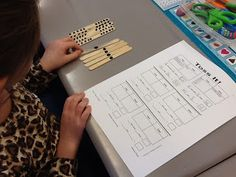 First Grade Bloomabilities: Toss It! Make a Quick Place Value Game- Students toss popsicle sticks, sort them into tens and ones, and record the number.