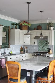 An Absolutely Gorgeous Kitchen Makeover - On A Budget! This is an amazing transformation, filled with so many custom touches. This post lists the improvements made and what materials were chosen and where they were purchased in order to stay within the budget - via Old Things New Blog