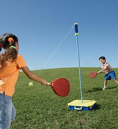 Tennis tether ball. Looks like birthday party and camping fun. I LOVE tether ball----what a good idea for something a little different!