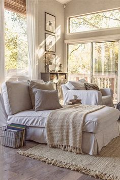 Calming & cozy white & beige living area with lots of sunlight