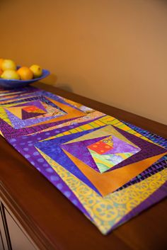 """Log Cabin/Split Level tablerunner (12 1/2"""" x 64 3/4""""), designed and made by Pam Dinndorf From the book """"quilts go wild"""""""