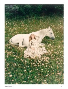 Fairy tale fashion fantasy - dream a little dream - girl in long white dress and white horse (fields of flowers)