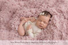 Newborn pose, baby on back, curled up newborn pose, newborn outfit, pink and cream newborn baby styling photoshoot, Anne Wilmus Photography, Pittsburgh newborn photographer