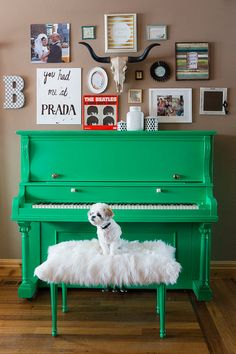Check out this beautiful up cycled piano. The perfect shade of green plus a fantastic gallery wall. #centsofstyle