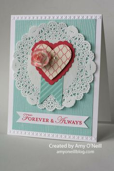 Supplies Used:  Stamps:  Hearts a Flutter, Loving Thoughts, Woodgrain  Ink:  Pool Party, Primrose Petals, Versamark  Paper:  Pool Party, Whisper White, Primrose Petals, More Amore Specialty dsp  Embellishments:  Hearts a Flutter framelits, Needlepoint Borders embossing folder, Tea Lace Paper Doilies, White Stampin' Emboss Powder, Pearl Basic Jewels, Artisan Embellishments Kit, Full Heart Punch