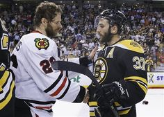 Chicago Blackhawks center Michal Handzus shakes hands with Boston Bruins center Patrice Bergeron after the Blackhawks beat the Bruins 3-2 in Game 6 of the NHL hockey Stanley Cup Finals Monday, June 24, 2013, in Boston. (AP Photo/Elise Amendola)