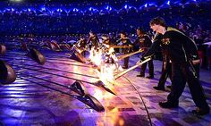 Seven young athletes light the Olympic Cauldron