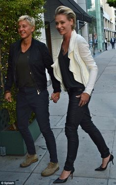 Love is in the air: Ellen Degeneres and Portia de Rossi looked as enamoured as ever on a date to Mr Chow in Los Angeles last night