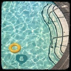 """Swimming Pool"" with yellow lifebelt 