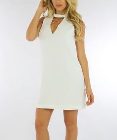 Flatter your curves with this lightweight sleeveless dress that features an alluring keyhole cutout below its choker neck.