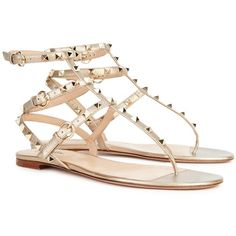Womens Flat Sandals Valentino Rockstud Gold Leather Sandals ($790) ❤ liked on Polyvore featuring shoes, sandals, leather flats, gold strappy sandals, gold sandals, leather strap sandals and studded flats
