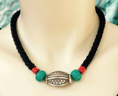 Choker with antique silver bead, coral and turquoise beads on black beaded Kumihimo cord. NStapleyDesigns on Etsy