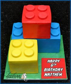Lego cake - use bread pan and either reeses or covered oreos for the pegs!