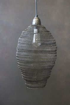 For those who want durable but delicate The Charcoal Wire Netting Ceiling Light is linked in a chain-effect mesh and tapers at the bottom like a