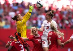 Canada moves on to quarterfinalists - Erin McLeod pounds away a ball during the second half.