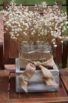 Centerpiece for rustic and cottage chic weddings using mason jars an baby's breath, burlap ribbon, old wood box