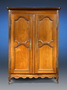 This excellent French Provincial double door armoire is beautifully crafted of fine walnut. Adorned with elegant, Rococo-inspired moulding and featuring exceptional well-preserved, original hardware, this armoire provides ample storage with two adjustable shelves. The first armoires appeared in France during the latter half of the 17th century and were most often the dominant feature of the home.