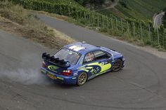 Subaru Impreza WRC rally car just about to do a master cylinder actuated handbrake turn