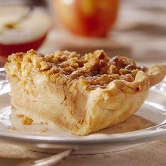 Apple Pudding Pie: It's a sweet marriage of two desserts. Double-apple bread pudding (fresh apples and applesauce) are baked in a pie with a streusel topper.