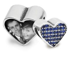 Sapphire Love Charm   <p><span>We all love to show off pictures of our kids to all who will let us, so why not carry your favourite picture on your wrist