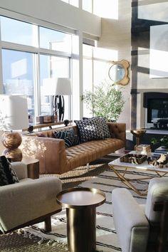 beautiful living room Strip rug-brown leather sofa plant