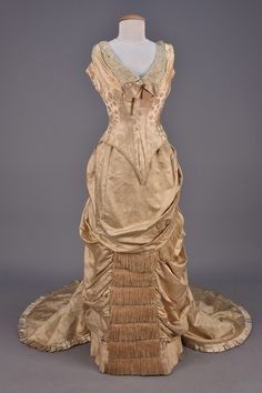 WORTH BUSTLE DRESS with TWO BODICES and CAPE, 1880. Ivory silk damask…
