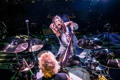 Behind the drum riser with Joey Kramer and Steven Tyler