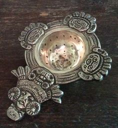 Nice old silver plated tea strainer Mexican / Peruvian Inca Azteca pattern