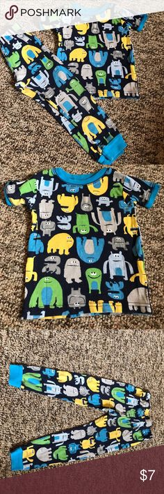 BOGO Free🎉Cute monster pajama set A cute monster pajama set. The main color is navy blue with a light blue collar, sleeve ends, and pant ends. The bottoms are stretchy at top and narrow around the ankles. The set is a size 2T Carter's Pajamas Pajama Sets