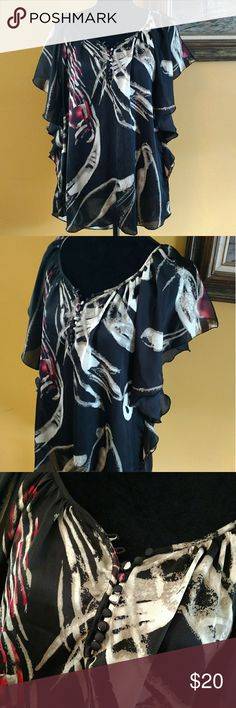 Gorgeous Black Rainn Tunic. Size M This is beautiful. Polyester satiny feel. Flowing lines and chic style tunic. Size medium. Excellent condition Black Rainn Tops Tunics
