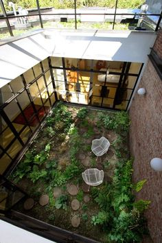 BROOKLYN HEIGHTS  Townhouse topped with an extensive sedum green roof and landscaped third floor semi-interior courtyard. By Goode Greene