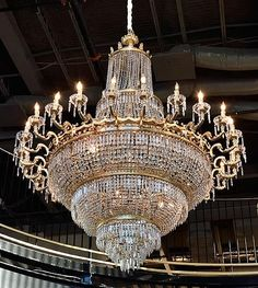 A FRENCH EMPIRE STYLE TWENTY-FOUR LIGHT CHANDELIER - by Morton Auctioneers & Appraisers