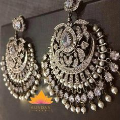 Wedding Jewelry Sabyasachi Inspired Silver Earrings - Description Warranty Information Silver Earrings with matching tikka Stones: Cz Diamond Silver Plated Returns Accepted Within 24 Hours of Delivery Indian Jewelry Earrings, Jewelry Design Earrings, Silver Jewellery Indian, Indian Wedding Jewelry, Bridal Jewelry, Silver Earrings, Silver Jewelry, Silver Ring, Silver Necklaces