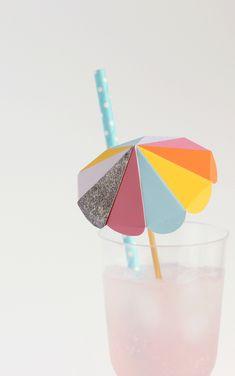 Bright paper umbrella drink stirs