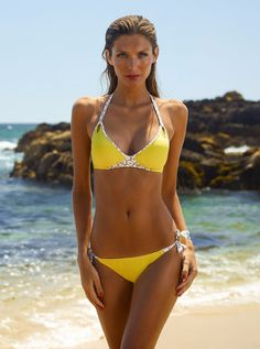 Chic and fun halterneck push-up bikini for great support and coverage with sexy keyhole design features and contrasting monochrome animal print. Bottom ties at side with contrasting knots. • Made in I
