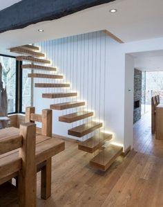 Diseño de escaleras modernas con tirantes de acero