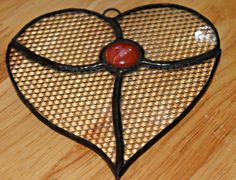 Stained glass gem heart.
