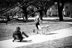 Woman, Girl and a dog in a park.